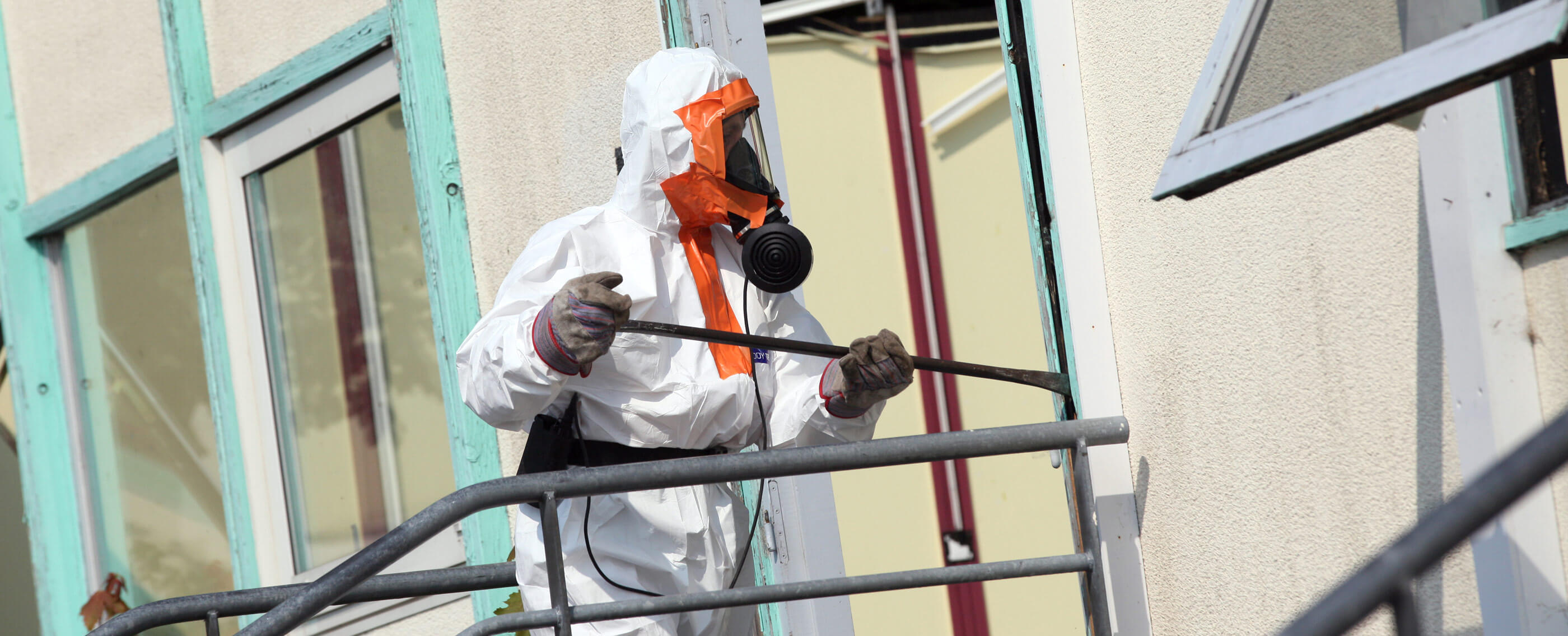 Asbestos Removal man in protective suit