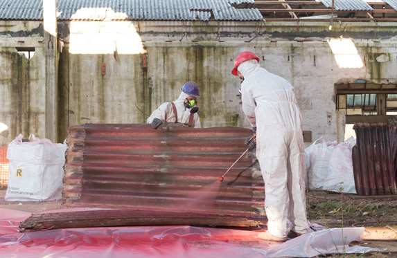 Asbestos removal - treating sheets of asbestos